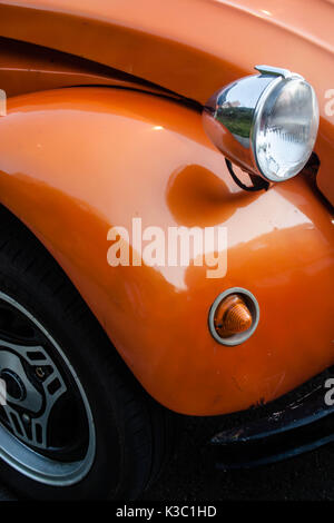 orange vintage car, citroen 2cv close up, detail of the front light and mudguard - Stock Photo
