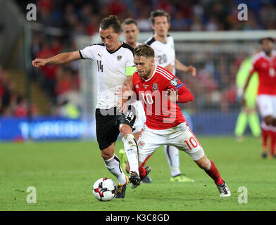 Austria's Julian Baumgartlinger (left) and Wales' Aaron Ramsey battle for the ball during the 2018 FIFA World Cup - Stock Photo