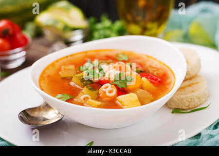 Minestrone - 'big soup', soup with many ingredients - a dish of Italian cuisine, light seasonal vegetable soup with - Stock Photo