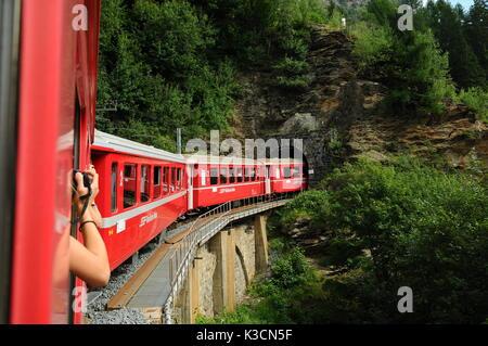 Switzerland:July 2012, Swiss mountain Train Bernina Express from Tirano to St. Moritz - Stock Photo