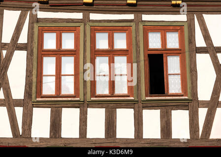 Windows of a traditional half timbered house seen in Germany - Stock Photo