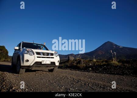 Chile, Araucania, national park Conguillio, volcano Llaima, car, - Stock Photo