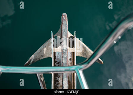 The anchor on the bow, sail boat prow as seen from above. In the background turquoise ocean water. Yacht equipment, - Stock Photo