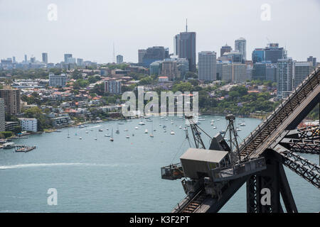 SYDNEY,NSW,AUSTRALIA-NOVEMBER 20,2016: Sailboats anchored on the waterfront with suspended scaffolding on the Harbour - Stock Photo