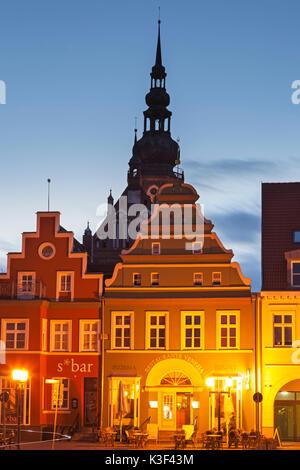 Houses on the marketplace with cathedral St. Nikolai, Hanseatic town Greifswald, Western Pomerania, Mecklenburg - Stock Photo