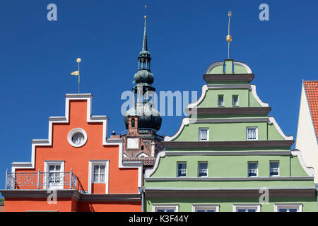 Houses on the marketplace, behind it the steeple of cathedral St. Nikolai, Hanseatic town Greifswald, Western Pomerania, - Stock Photo