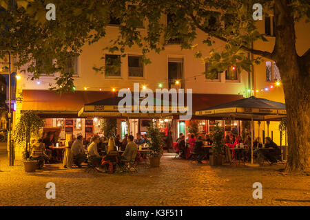 Terrace of the restaurant house Müller in the Severinsviertel Cologne, North Rhine-Westphalia, Germany - Stock Photo