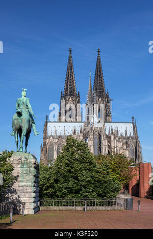 Equestrian statue of emperor Wilhelm in front of the Cologne Cathedral, Cologne, North Rhine-Westphalia, Germany - Stock Photo