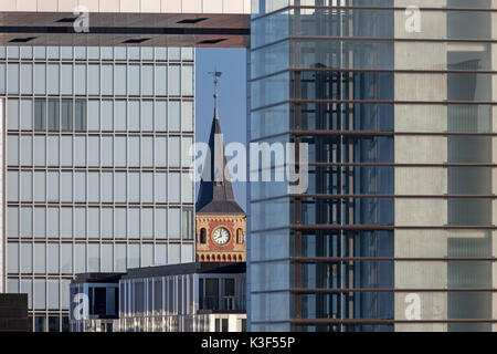 Tower of the old port authority between the crane houses in the Rheinauhafen (Rheinau harbour), Cologne, North Rhine - Stock Photo
