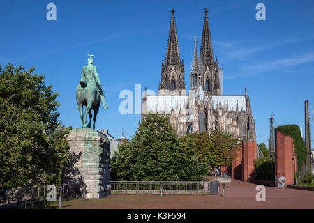 Equestrian statue of emperor Wilhelm II in front of Cologne Cathedral, Cologne, North Rhine-Westphalia, Germany - Stock Photo