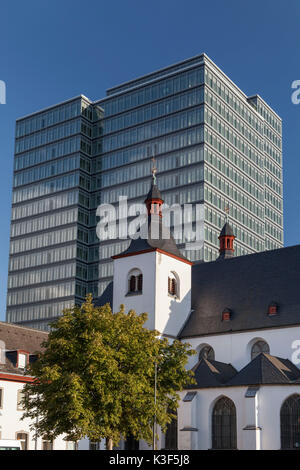 Abbey old St. Heribert in front of the Lanxess Tower in Köln-Deutz, Cologne, North Rhine-Westphalia, Germany - Stock Photo