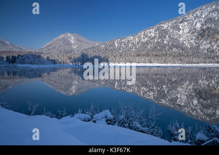 Bavarian Alpine foothills are reflected at the Sylvenstein Dam, Fall village near Lenggries, Upper Bavaria, Bavaria, - Stock Photo