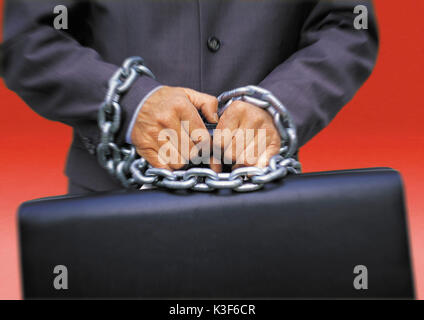 Man holds briefcase with tied up hands - Stock Photo