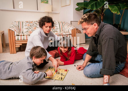 family at playing Ludo - Stock Photo
