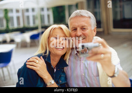 Couple takes a photo of itself at the cafe - Stock Photo
