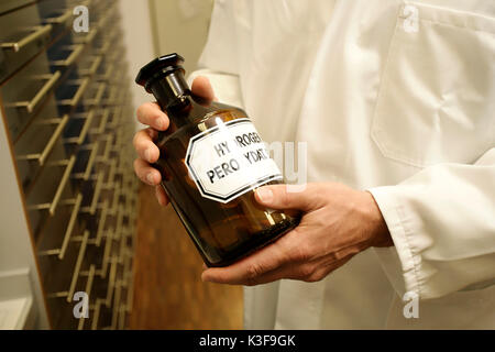 chemist with chemist bottle in the hands - Stock Photo