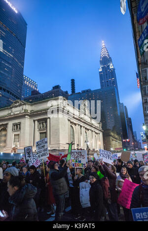 Protesters with Signs Near Grand Central Terminal during Women's March, New York City, New York, USA, January 21, - Stock Photo