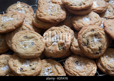 Close-Up of Homemade Chocolate Chip Cookies on Cooling Rack - Stock Photo