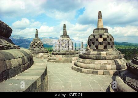 Stupas on the temple complex of Borobodur, Java, Indonesia - Stock Photo