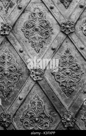 Black metal texture floral pattern background. Forging. Fasteners. - Stock Photo