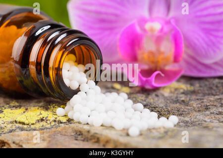 Nature medicine with homoeopathic Globuli - Stock Photo