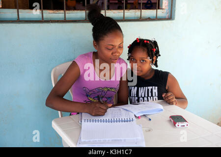 The Dominican Republic, peninsula Samana, tablespoon Limon, child at school assignments - Stock Photo