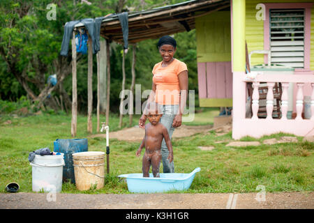 The Dominican Republic, peninsula Samana, los Galeras, mother with child - Stock Photo