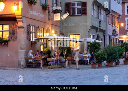 Dinkelsbühl, in the evening enlightened restaurant at the Old Town - Stock Photo