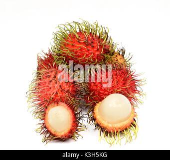 Ripe rambutan fruits isolated on white - Stock Photo