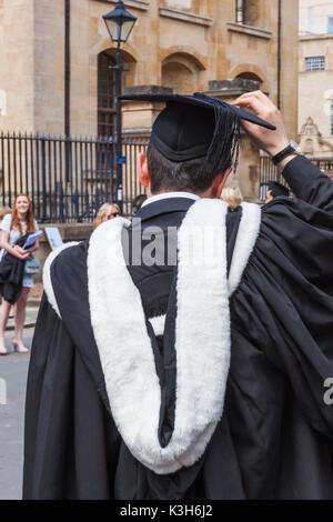 England, Oxfordshire, Oxford, Graduation Gown Stock Photo: 110605067 ...