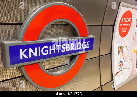 England, London, The Underground, Knightsbridge Station Sign - Stock Photo