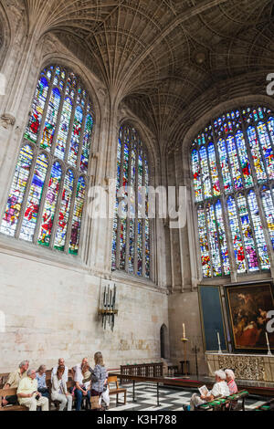 England, Cambridgeshire, Cambridge, King's College Chapel, Tour Group and Stained Glass Windows - Stock Photo