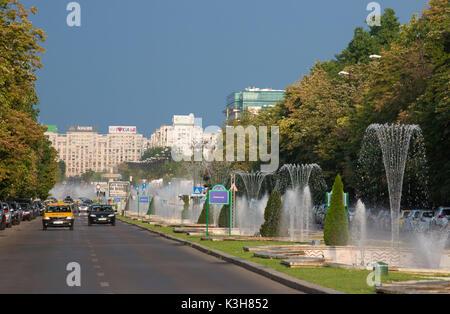 Romania, Bucharest City, Unirii Boulevard, fountains - Stock Photo
