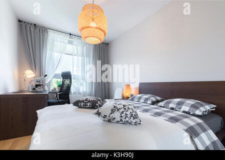 Modern bedroom interior design in wooden finish - Stock Photo