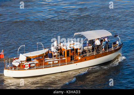 England, London, Small Luxury Motorboat on River Thames - Stock Photo