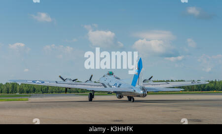 Vintage Boeing B-17 Flying Fortress bomber prepares for takeoff from the Peterborough Ontario airport as part of - Stock Photo