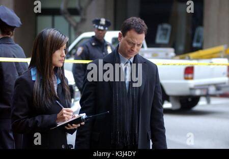"""Til Death Do We Part"" CSI: NY. Photo: Patrick Ecclesine/ CBS Stars KELLY HU and GARY SINESE. Licensed - Stock Photo"