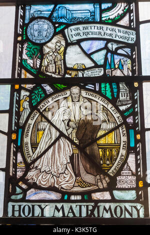 England, London, Wapping, St Peter's London Docks Catholic Church, Stained Glass Window depicting Marriage Ceremony - Stock Photo