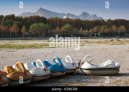 Iran, Central Iran, Esfahan, swan boats on dried out riverbed of the Zayandeh River - Stock Photo