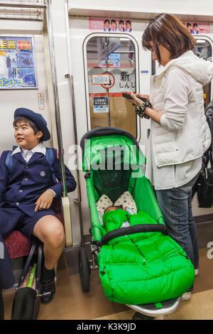 Japan, Hoshu, Tokyo, Tokyo Subway, Train Passengers - Stock Photo