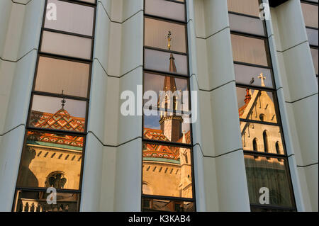 Hungary, Budapest, Buda district, Mathias church reflecting on Hilton Hotel 's windows, Castle Hill listed as World - Stock Photo