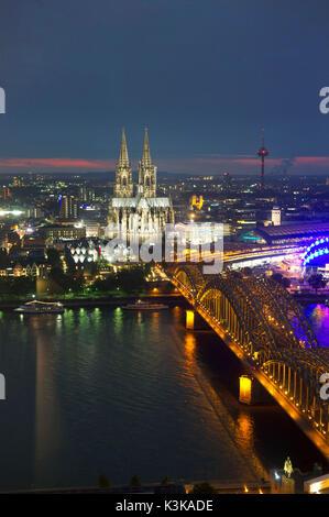Germany, North Rhine-Westphalia, Cologne (Köln), the Rhine River, the bridge Hohenzollern-Brücke and the cathedral - Stock Photo