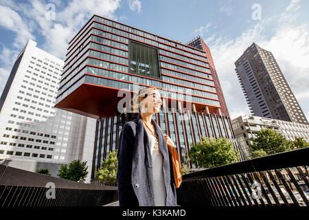 Woman in Rotterdam city - Stock Photo