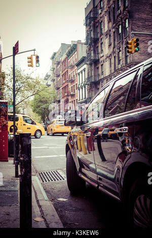 Yellow cabs and Streetview reflections in car varnish, Manhatten, New York, USA - Stock Photo