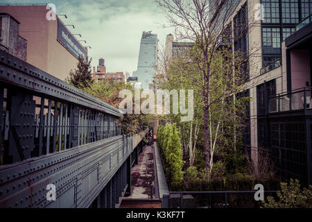 The High Line is a public park built on a historic freight rail line elevated above the streets on Manhattan's West - Stock Photo