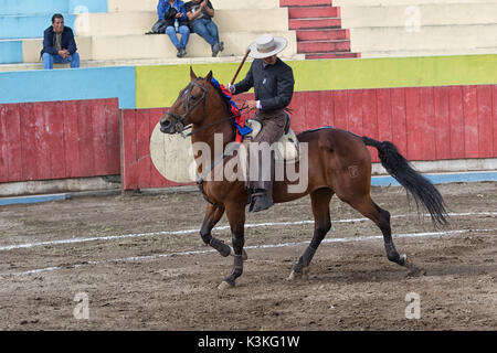 June 18, 2017, Pujili, Ecuador: bullfighter on horseback is getting ready for the ritual fight in the arena - Stock Photo