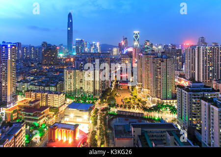 Shenzhen skyline at twilight with the tallest building of the city on background: the Ping An IFC, China - Stock Photo
