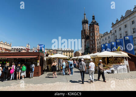 Poland, Lesser Poland, Cracow / Krakow. The Cloth Hall, Main Square and St. Mary's Basilica. The second largest - Stock Photo