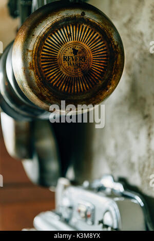 old stove, hanging pans - Stock Photo