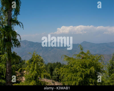 Beautiful view of the Himalayas on the background of blue sky. Shimla, Himachal Pradesh, India - Stock Photo